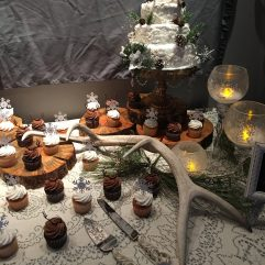 antler and wood round cake stands and servers for rent for rustic montana wedding