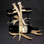 Deer antler wine glass and bottle rack image