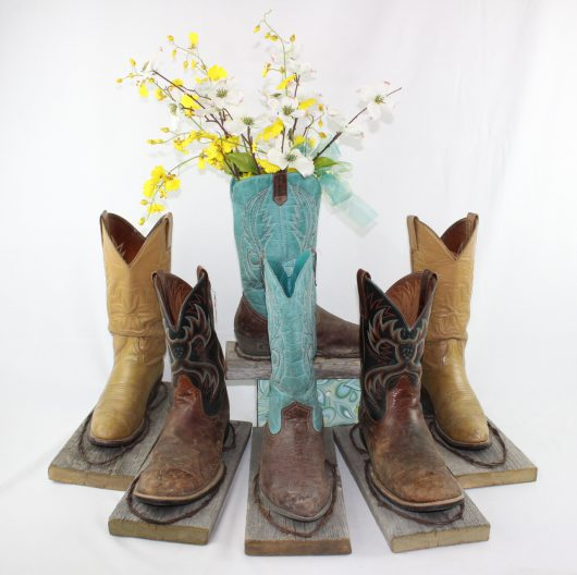 Cowboy boot flower holder centerpieces for rent for rustic montana wedding
